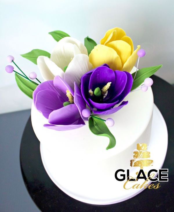 beautiful custom wedding cake Austin purple yellow white